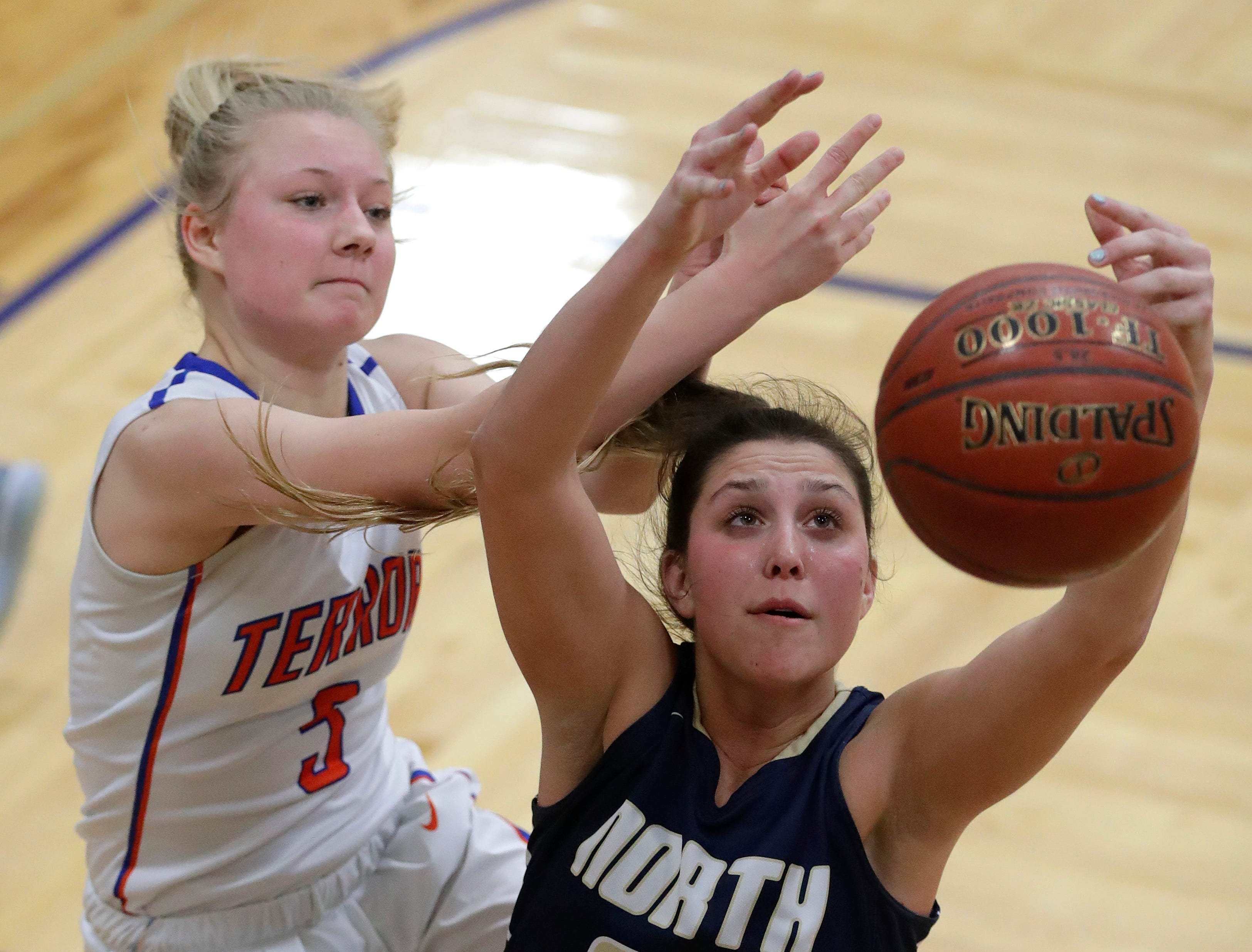 Appleton West High School's Bree Workman (5) defends against Appleton North High School's Paige Schabo (23) during their girls basketball game Friday, January 25, 2019, at Appleton West High School in Appleton, Wis. 