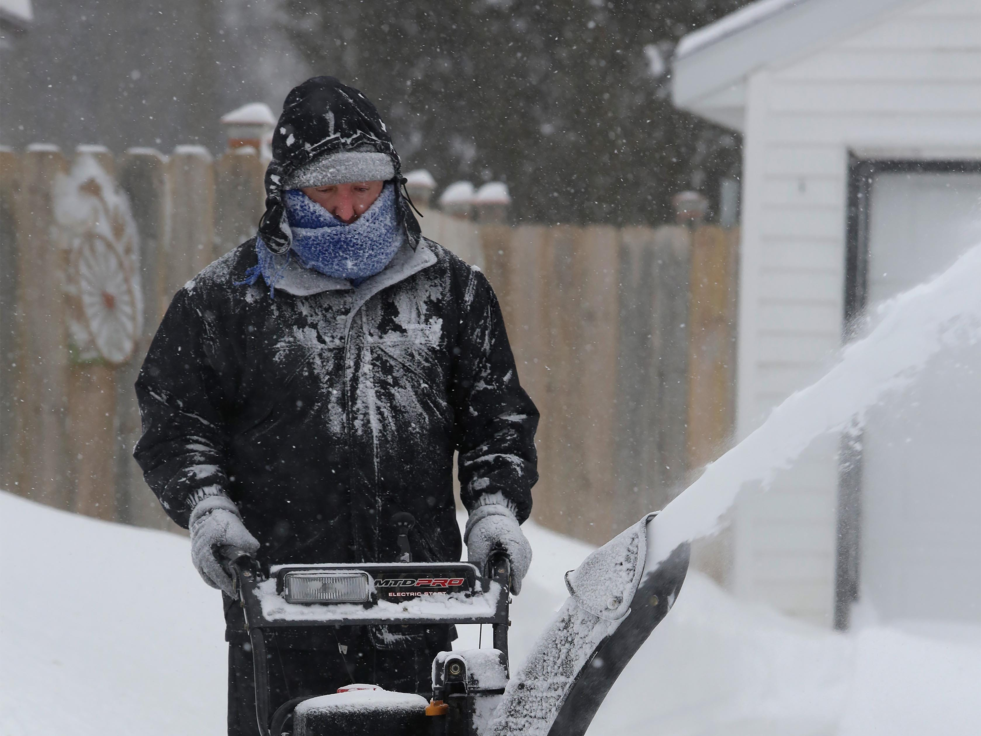 Dzml Crnovrsnin of Sheboygan blows snow out of his driveway at his north side home, Monday, Jan. 28, 2019, in Sheboygan, Wis.