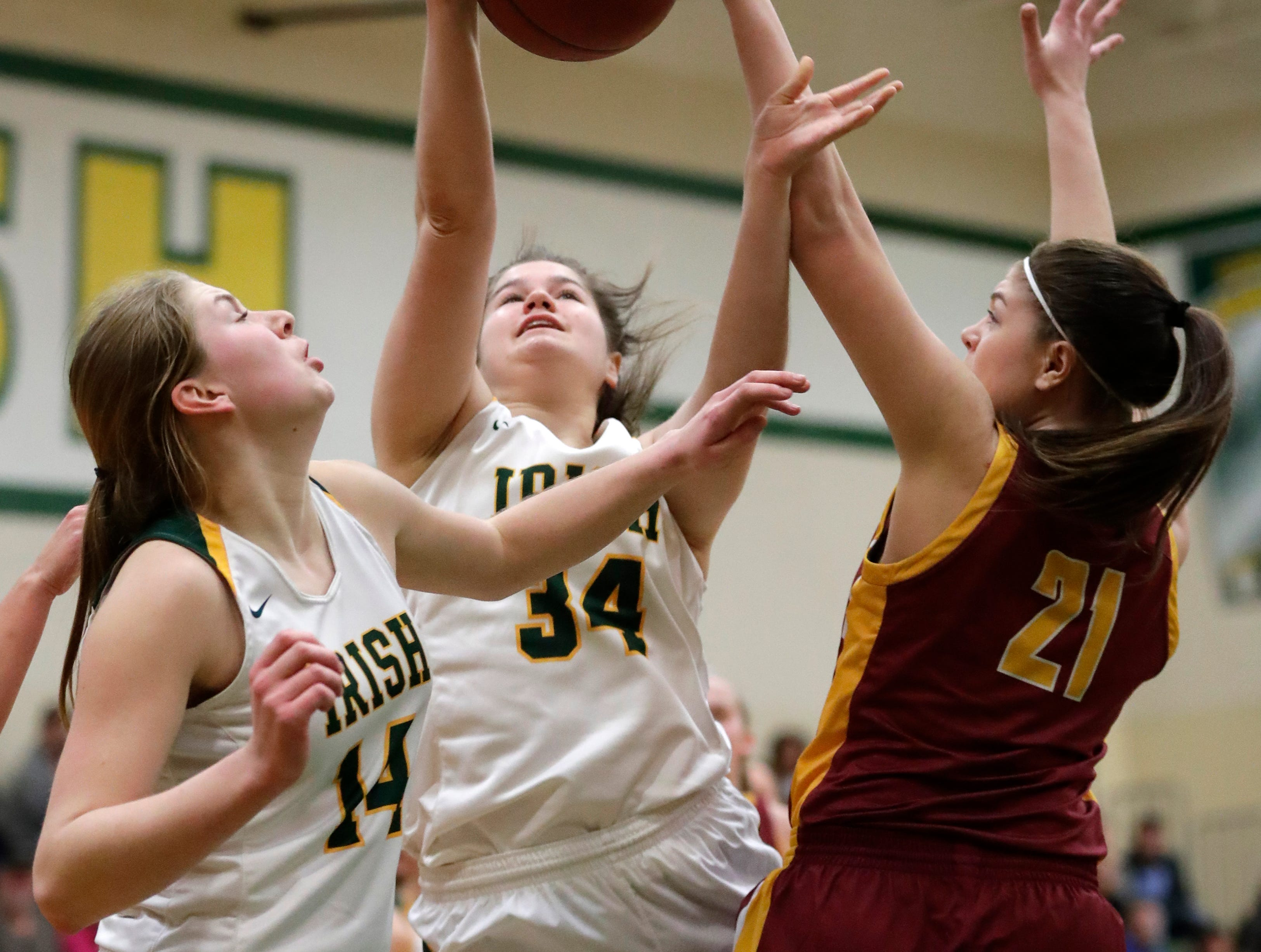 Freedom High School's Linnea Willer (34) puts up a shot against Luxemburg-Casco High School's Paige Skubal (21) as Karissa Wurster (14) positions herself for a potential rebound during their girls basketball game Thursday, January 24, 2019, in Freedom, Wis. Dan Powers/USA TODAY NETWORK-Wisconsin