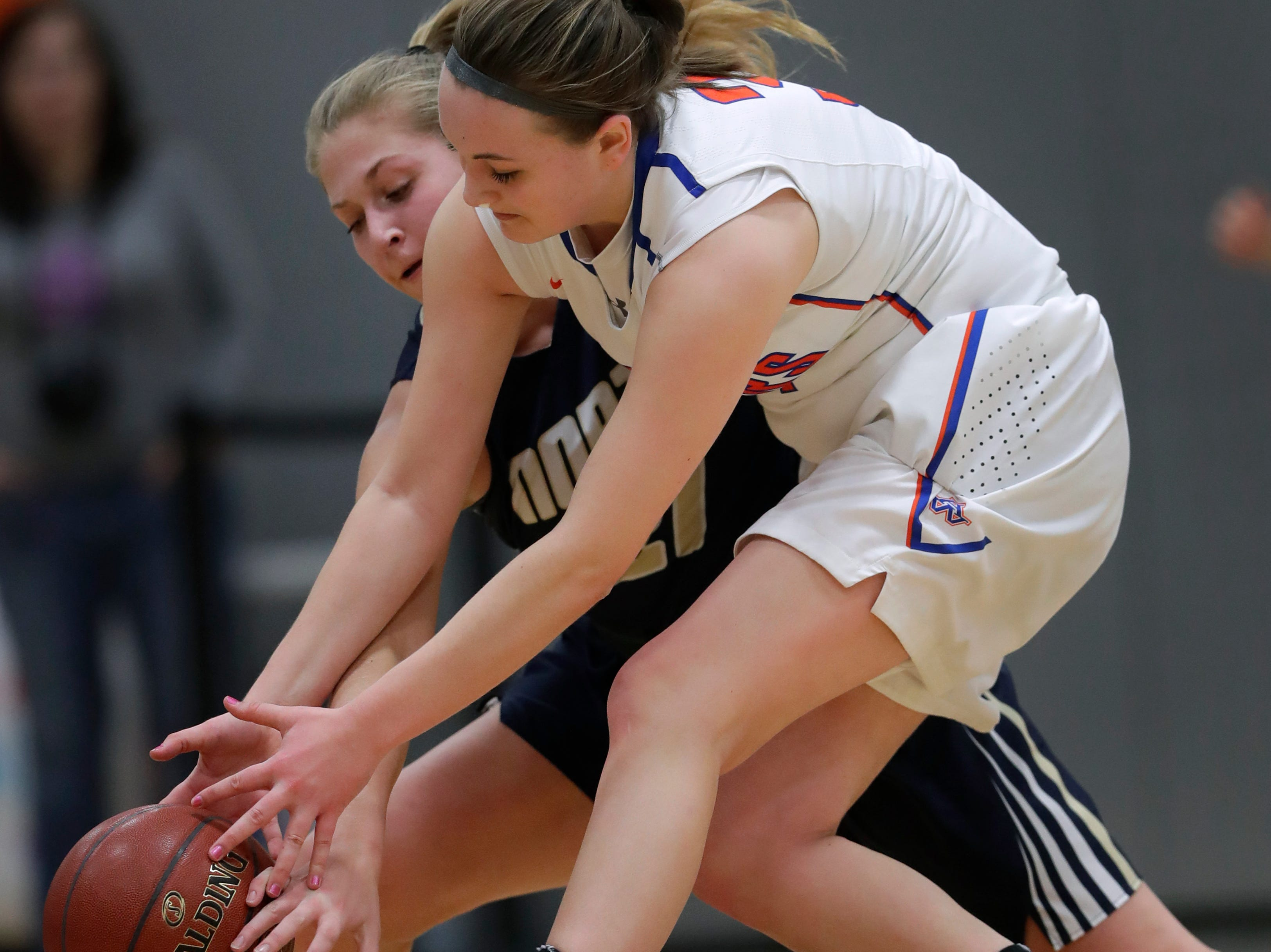 Appleton North High School's Lilli Van Handel, left, battles for a loose ball against Appleton West High School's Christy Fortune during their girls basketball game Friday, January 25, 2019, at Appleton West High School in Appleton, Wis. 