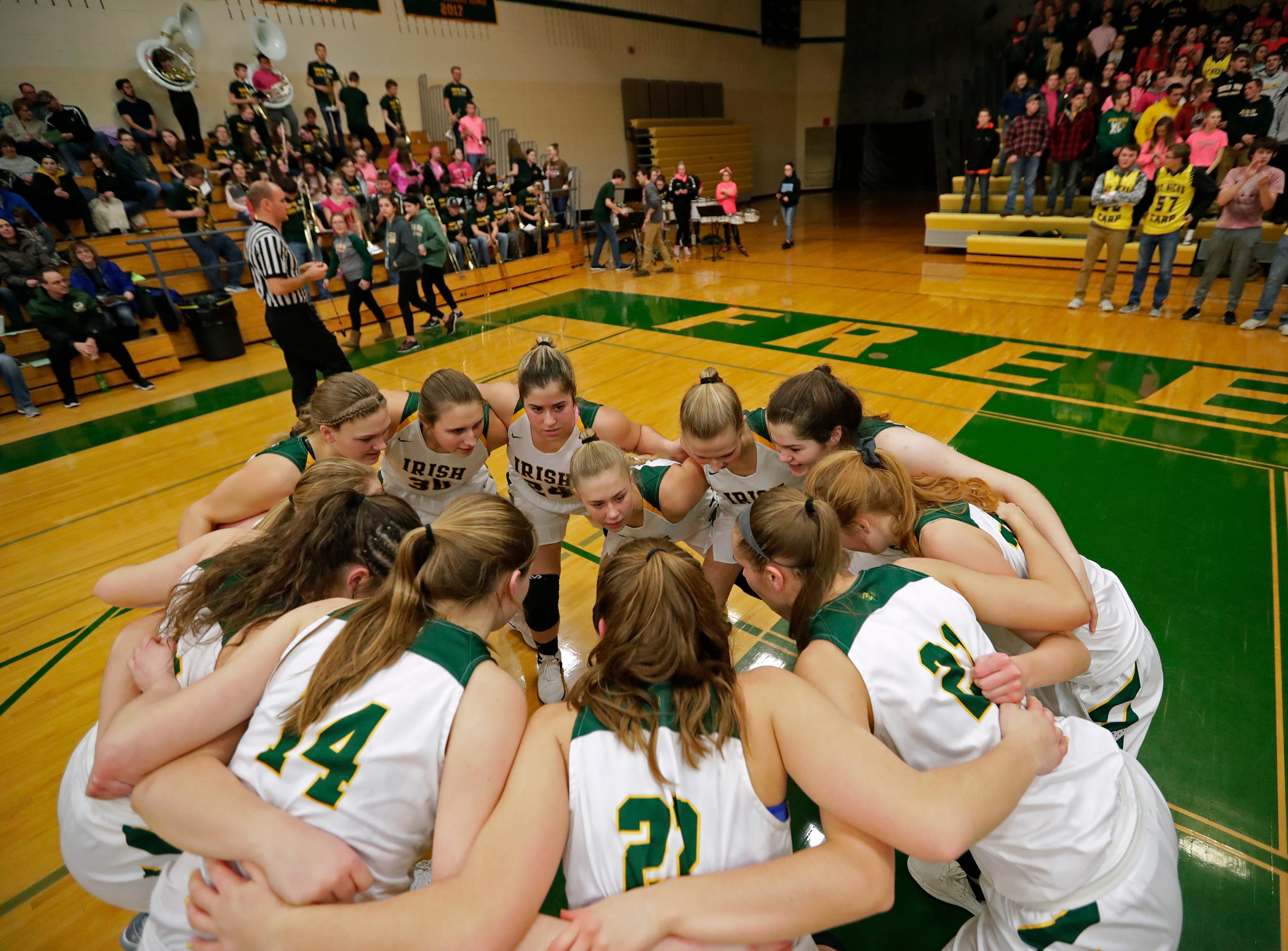 Freedom High School's gather moments before tip off against Luxemburg-Casco High School during their girls basketball game Thursday, January 24, 2019, in Freedom, Wis. 