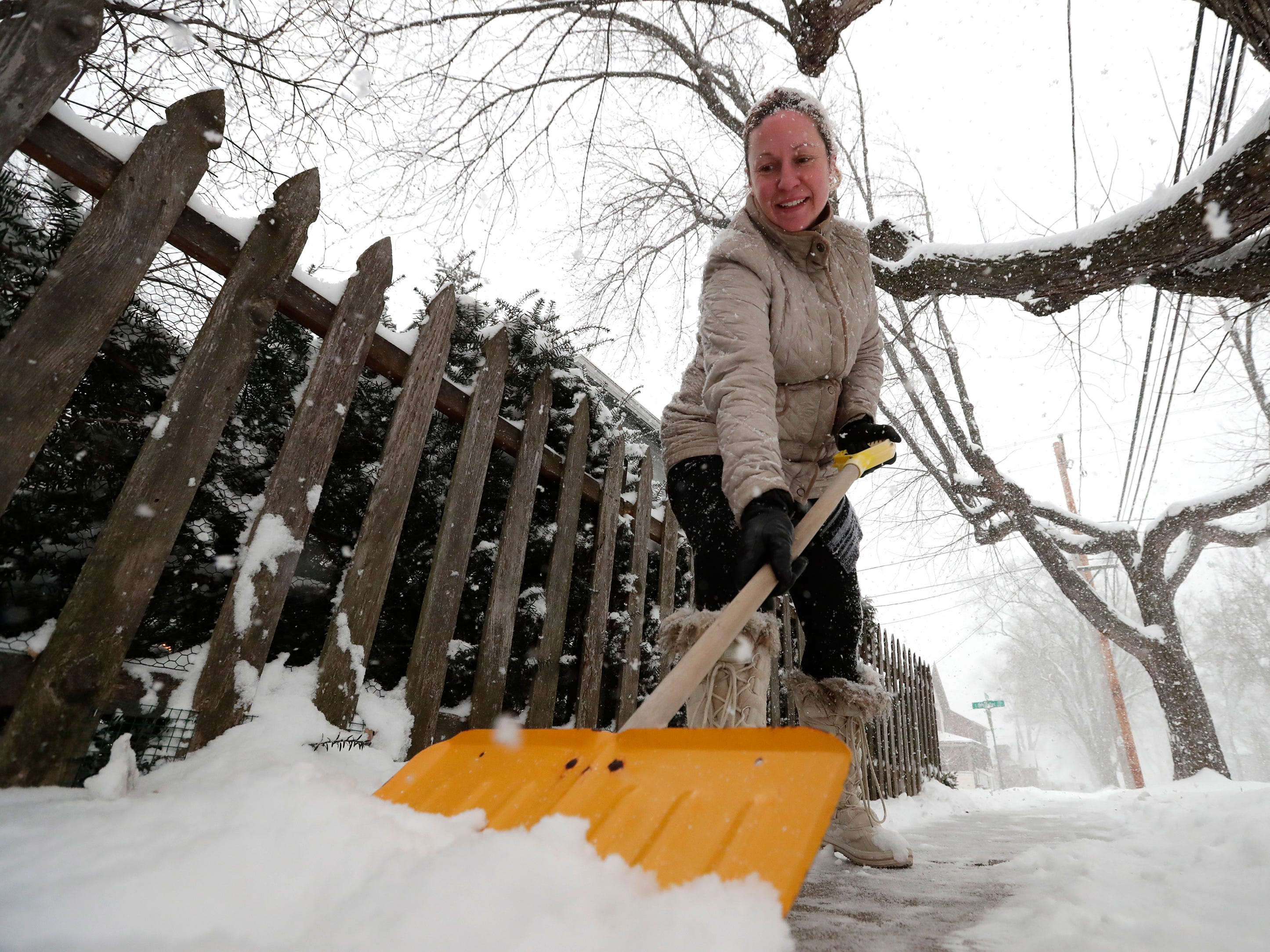 Paige Knoke of Appleton shovels the sidewalk in front of her home along Brewster Street during a snowstorm Wednesday, January 23, 2019, in Appleton, Wis. 