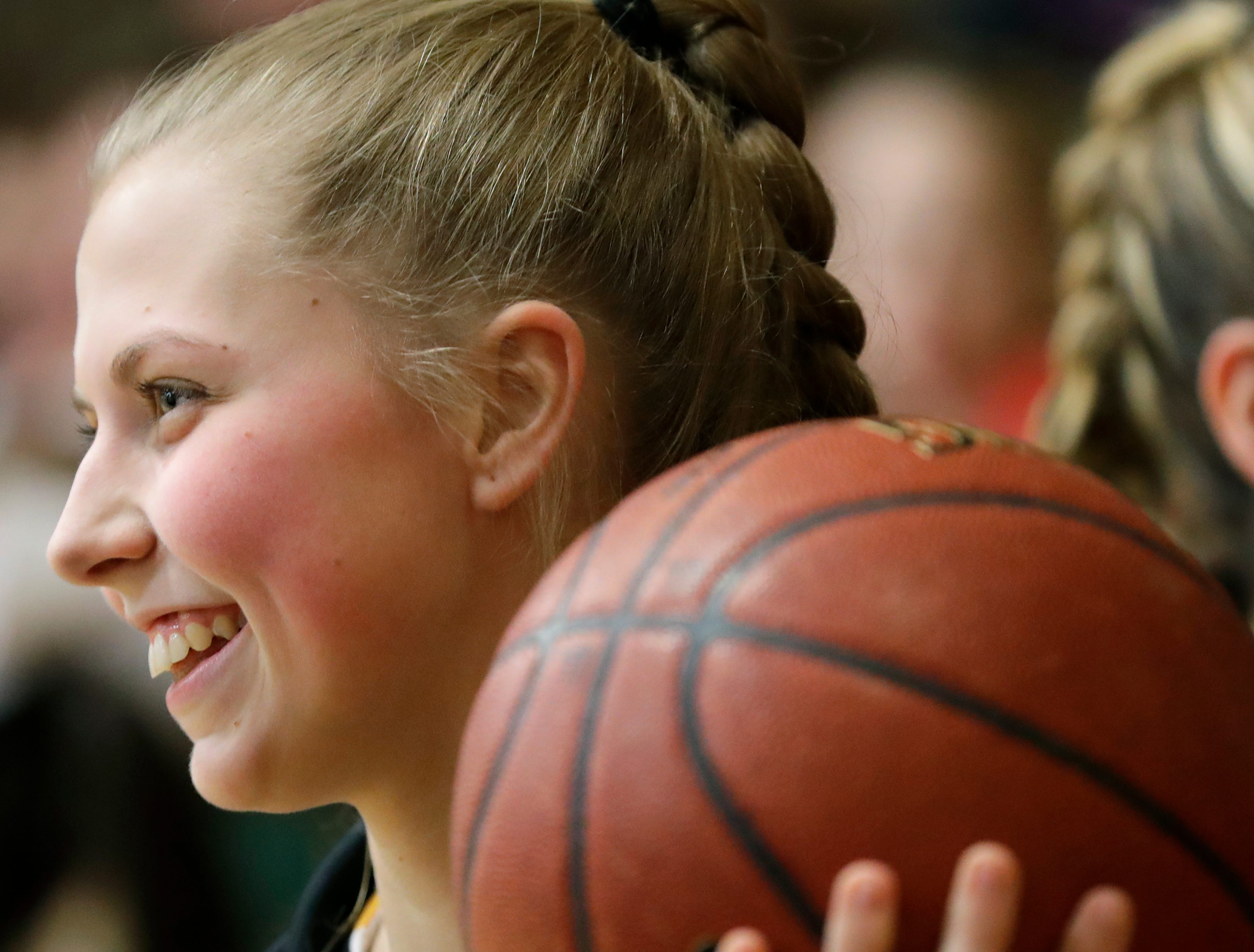 Freedom High School's Kelly Garrett is all smiles prior to taking to the court against Luxemburg-Casco High School during their girls basketball game Thursday, January 24, 2019, in Freedom, Wis. 