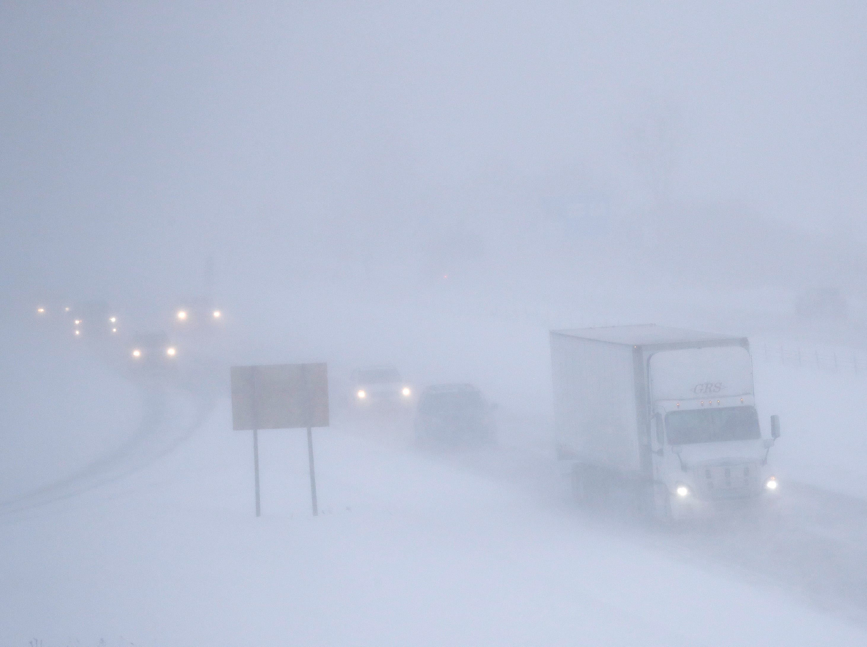 Traffic moves slowly northbound in poor visability conditions along I-41 during a snowstorm Monday, January 28, 2019, in Appleton, Wis.