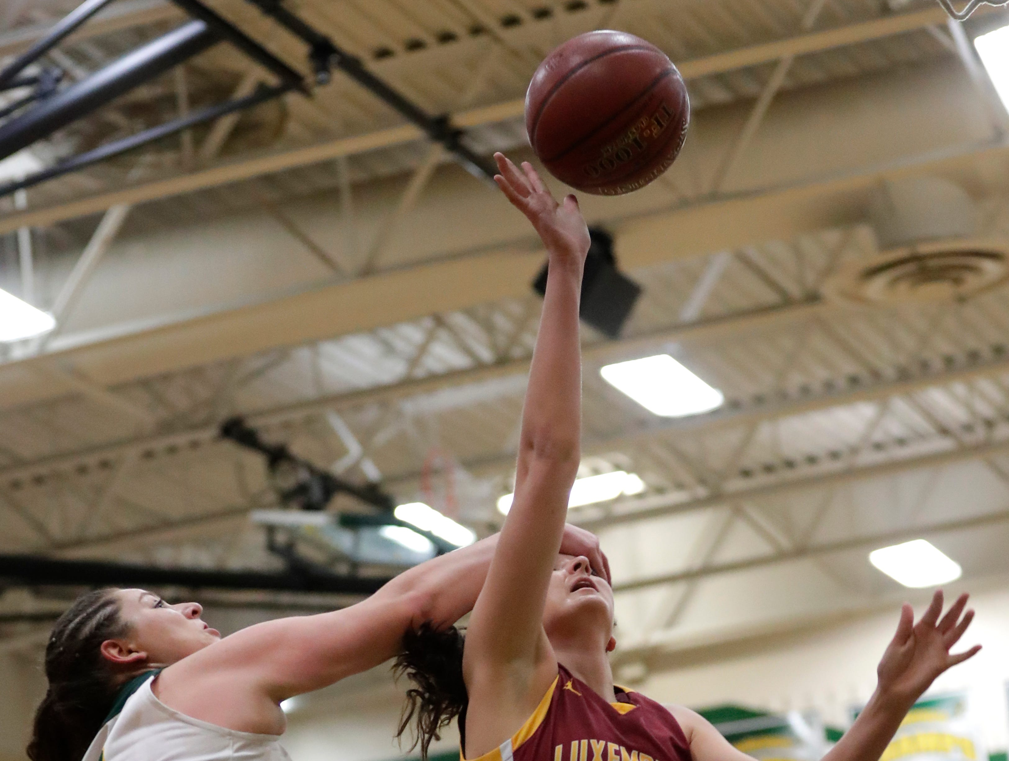 Freedom High School's Cameron Evers (10) defends against Luxemburg-Casco High School's Cassie Schiltz (3) during their girls basketball game Thursday, January 24, 2019, in Freedom, Wis. 