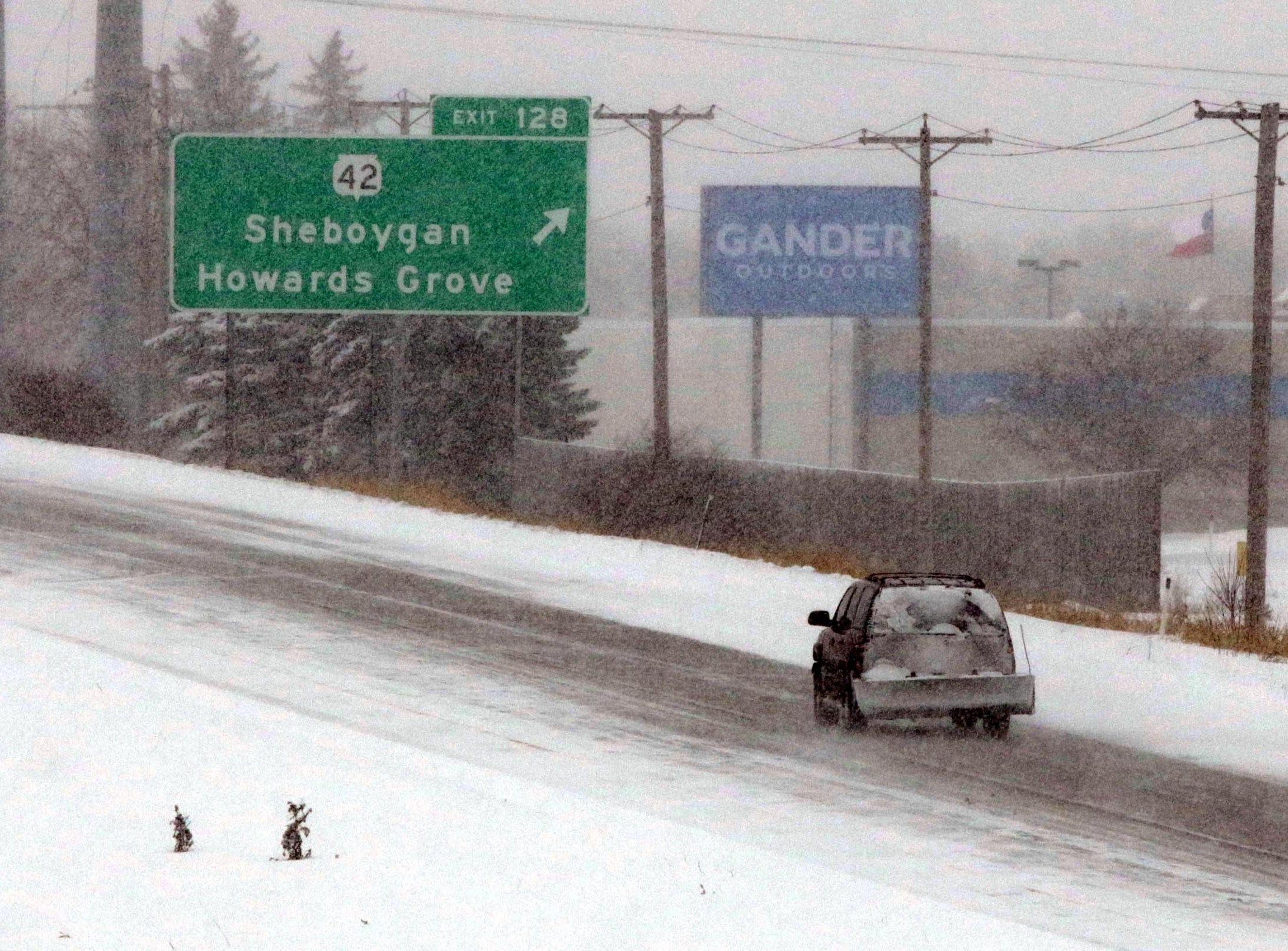 Traffic goes northbound on Interstate 43, south of the state Highway 42 exit, Monday, January 28, 2019, in Sheboygan, Wis. According to Sheboygan County Sheriff Cory Roesler, due to the many closures of businesses and schools, incidents have been kept to a minimum.