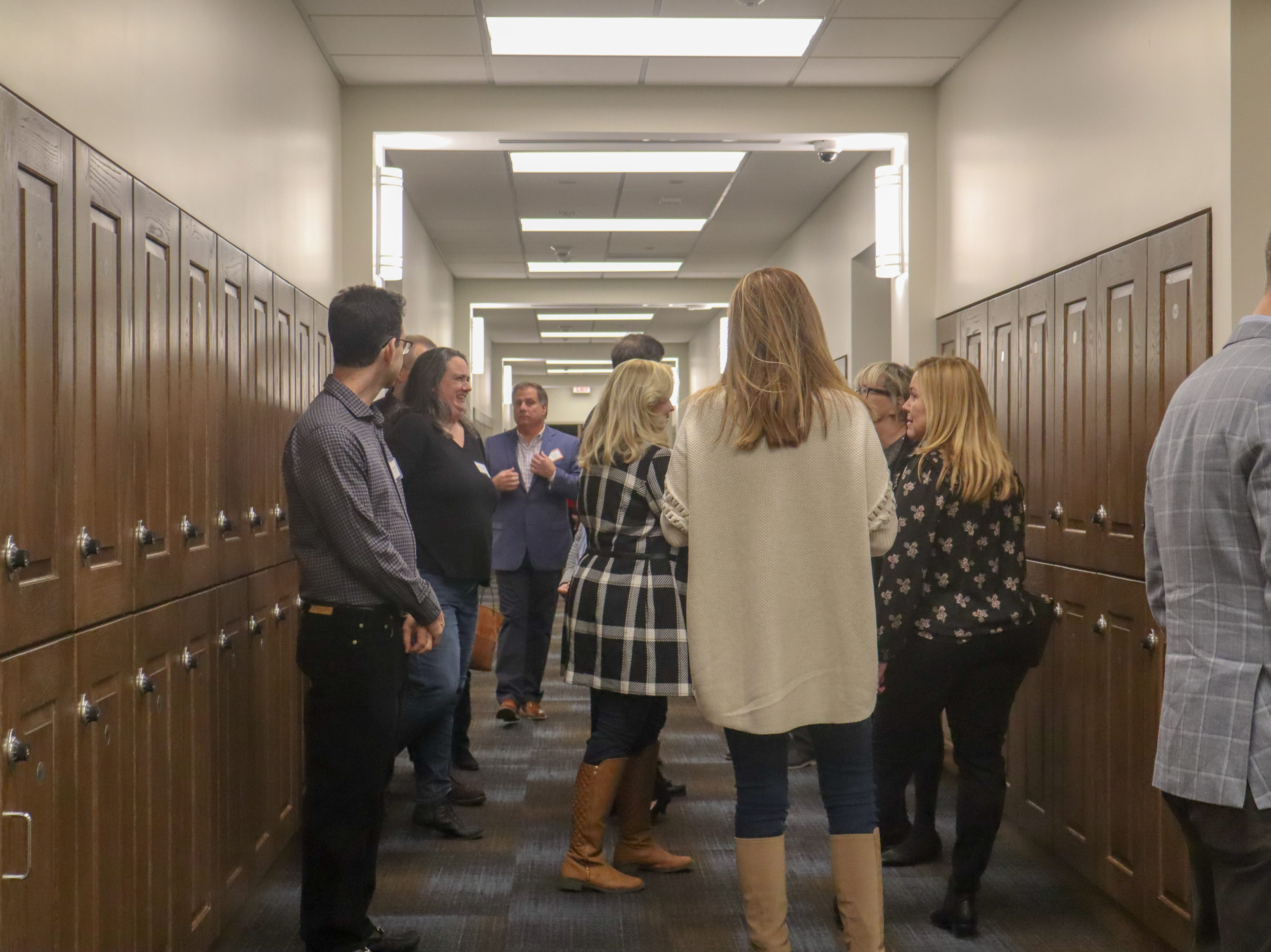 People walk the hallway at the unveiling of the new academic wing at the all-girls' private school on Fort Monmouth on Jan. 25, 2019.