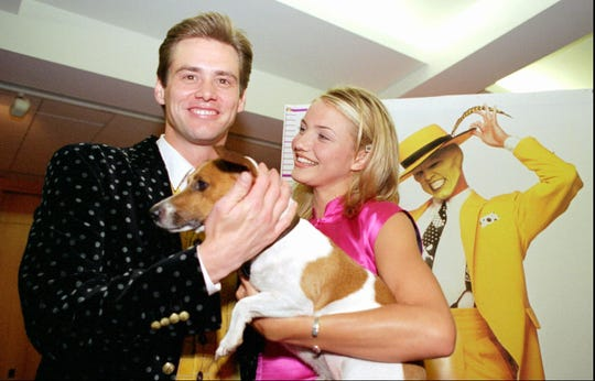 """Jim Carrey, left, poses with co-stars Cameron Diaz and Milo before the premiere of """"The Mask,"""" Thursday, July 28, 1994, at the Academy of Motion Picture Arts and Sciences in Los Angeles."""