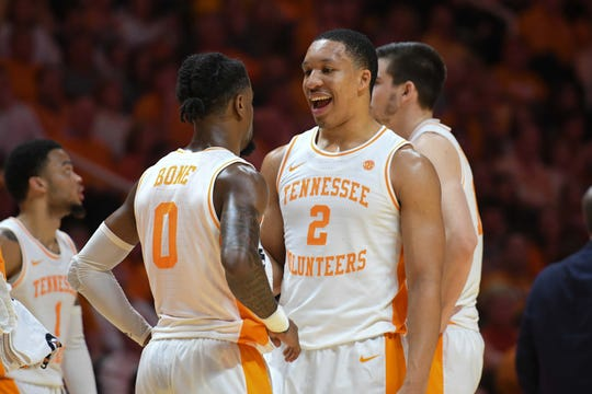 Tennessee Volunteers guard Jordan Bone (0) and forward Grant Williams (2) speak during the second half against the West Virginia Mountaineers at Thompson-Boling Arena.
