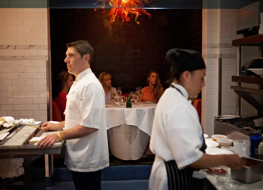 Nicholas Harary (left), chef and owner of Restaurant Nicholas, offers a chef's table overlooking the kitchen of his Middletown restaurant.