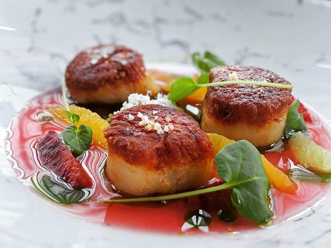 Pan-seared scallops with winter citrus fruits at Restaurant Nicholas in Middletown.