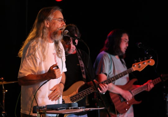 Sandy Mack, left, pictured in 2012, performs with Panama Dead at Langosta Lounge in Asbury Park on Feb. 9.