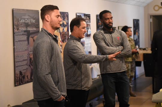 Texas Rangers Connor Sadzeck, Don Wakamatsu and Taylor Hearn look at a display at the Dyess Air Force Base Welcome Center and Museum on Monday.