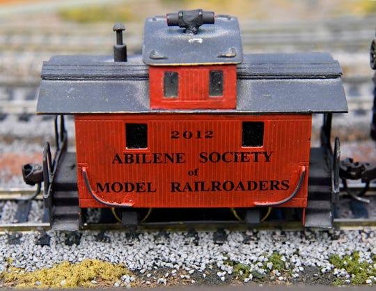 A caboose advertises the model railroad club Dec. 8.