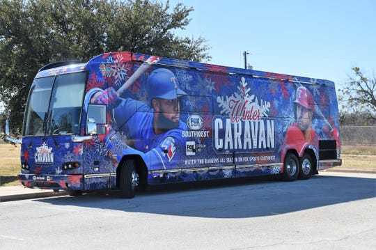 The Texas Rangers Winter Caravan bus parks outside the Dyess Air Force Base Welcome Center and Museum on Monday. Rangers pitchers Connor Sadzek and Taylor Hearn and bench coach Don Wakamatsu visited the base and met members of the Air Force and their families.