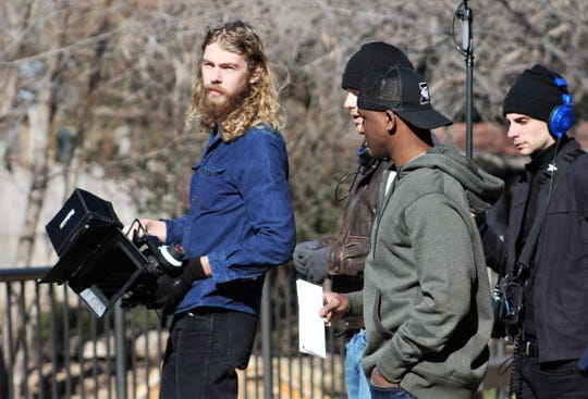 "Crew for the film ""Brother's Keeper"" prepares actor Acorye White, center, as running back Hershel Sims, for a scene at the Abilene Zoo. The film is about Abilene High School's 2009 state football championship team, of which Sims was a member."