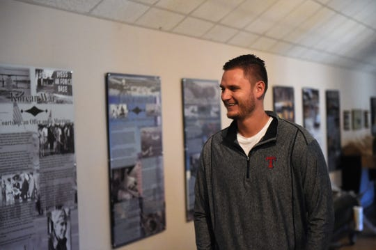 Texas Rangers pitcher Connor Sadzeck reads a display at the Dyess Air Force Base Welcome Center and Museum on Monday. Sadzeck pitched for a season at Howard College in Big Spring before being drafted by the Rangers in 2011.