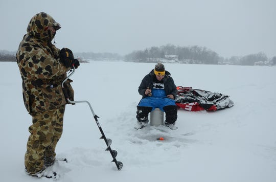 Joe Olaughlin and his grandson, Brenden Massa, both of Battle Creek were ice fishing Monday on Goguac Lake.