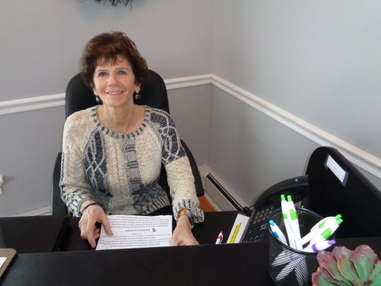 Susan Stoddard works the reception desk at the Life Choices Center of Binghamton. Being a receptionist is one of several volunteer jobs that she does for the center, where she has volunteered for 10 years.