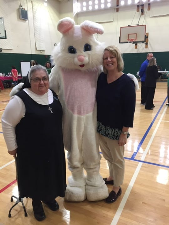 Sister Joanna Monticello, left, and Mercy House's executive director, Linda Cerra, right, with the Easter bunny.