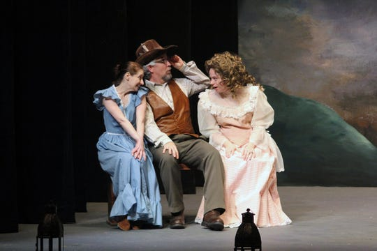 Rosiland (Sasha Alamano, left) and Celia (Chelsea Thompson) are accompanied by the court fool, Touchstone (Wallace Ross).