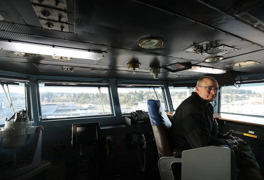 Capt. Matthew Paradise, commanding officer of the USS Carl Vinson, sits on the bridge of the carrier, which recently arrived in Bremerton in preparation for maintenance at Puget Sound Naval Shipyard.