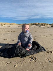 Babies instinctively sit with perfect posture, as 11-month-old Jack Reich of Portland, Oregon, demonstrates on a recent visit to the beach.