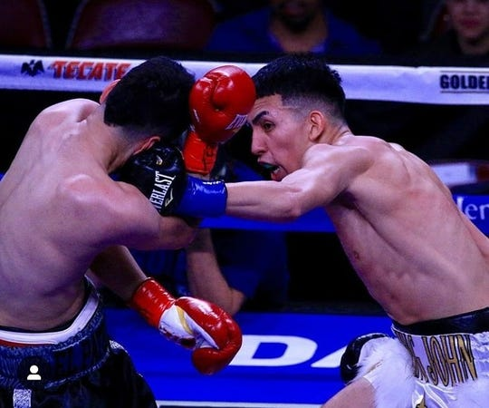 John Rincon, right, won a four-round unanimous decision over Alex Santana at the Toyota Center in Houston on Saturday. Rincon, a Corpus Christi native, is 2-0 in young pro boxing career.