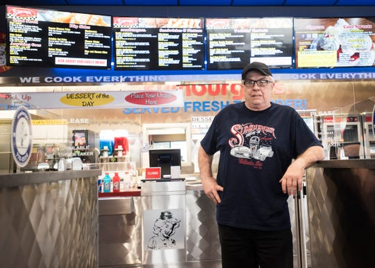 Bill Righter, owner of Sumburger for the past 31 years, stands in the ordering entrance of his second Sumburger location on Western Avenue. Righter considers Sumberger a Chillicothe staple and wants to continue its local legacy.