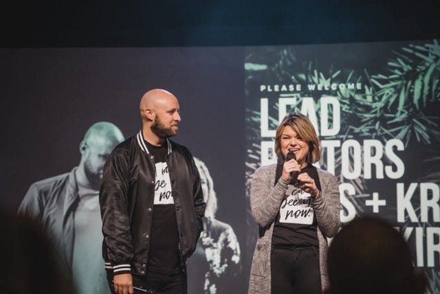 Lead Pastors Chris and Kristyn VanBuskirk speak onstage at Centerpoint Church.