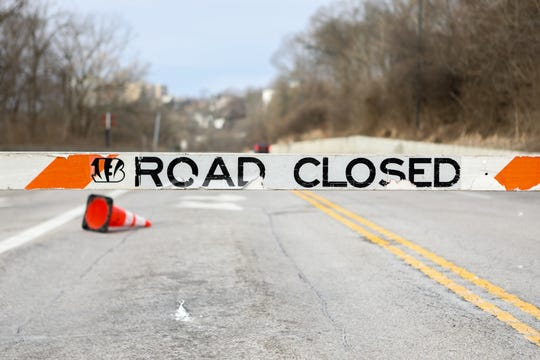 Columbia Parkway is closed between Kemper Lane and Torrence Parkway due to a landslide. Crews are working on cleaning it up on Monday Jan. 28, 2019. Road closed sign at Torrence and Columbia Parkway,