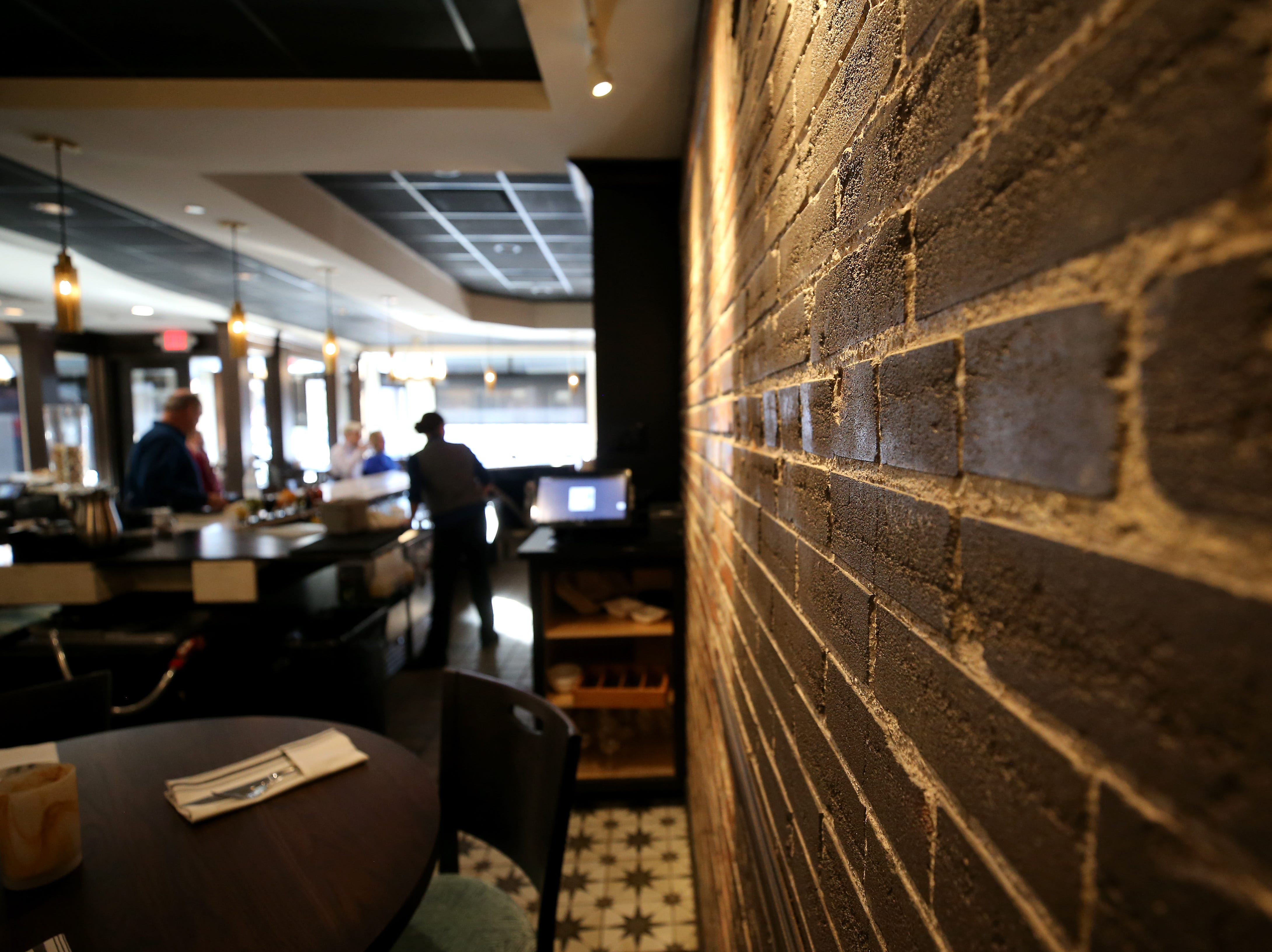 Exposed brick is featured in the bar area, pictured, Friday, Jan. 25, 2019, at Tano Bistro restaurant in Loveland, Ohio.