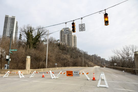 Columbia Parkway is closed between Kemper Lane and Torrence Parkway due to a landslide. Crews are working on cleaning it up on Monday Jan. 28, 2019. Road closed sign at Kemper Lane and Columbia Parkway,