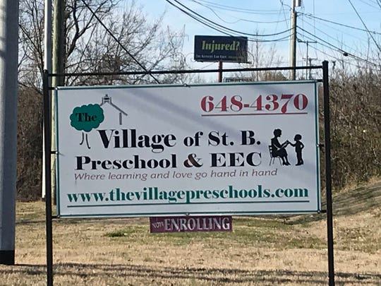 A sign outside The Village of St. B Preschool advertises they are enrolling students, in spite of allegations that the school is understaffed.