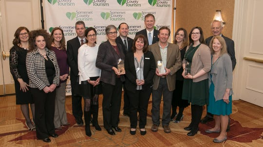 Jacqueline Morales (far left), Somerset County director of tourism, with winners and presenters of the 2019 Salute to Tourism Awards. (L to R): Niquole Primiani of the NJ Historical Commission; Stephanie Moench, board president, Somerset County Cultural & Heritage Commission; Leigh Zona, Mary Lev and Elie Trubert, Center for Contemporary Art; Adam Perle, ArtPride New Jersey; Gina DiFrancesco and John McPartlan, Bridgewater Marriott; Michael Malekoff, Tour of Somerville; Wendy Ewen, Unity Bank; Kaitlyn Bundy, manager, Somerset County Cultural & Heritage Commission; Joe and Dottie Saling, members of the U.S. Cycling Hall of Fame.