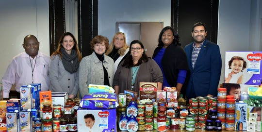 (Left to right) Division of Social Services Director Charles Gillon, Freeholder Kimberly Palmieri-Mouded, Freeholder Chair Bette Jane Kowalski, Division of Social Service employees Felice Twaddle and Tina Lopez, Human Services Director Debbie-Ann Anderson, and Freeholder Sergio Granados.