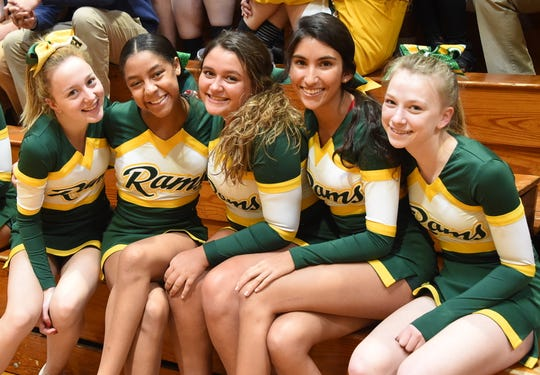 Wardlaw+Hartridge cheerleaders Claire Jeffery of Westfield, Zoe Rose of Watchung, Judy Minnium of Scotch Plains, Camila Martinez of Scotch Plains and Olivia Brown of South Plainfield take a break in the action during the Winter Games.