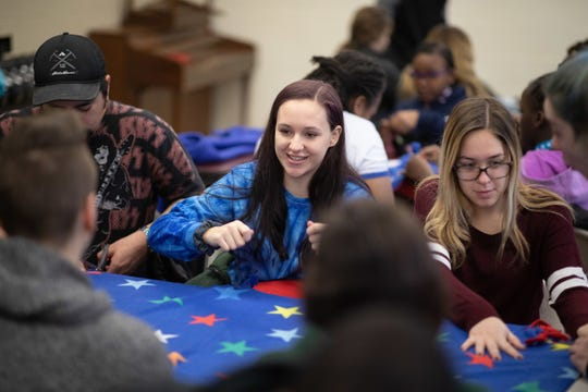 Volunteers at Somerville YMCA make  no-sew lap blankets for patients at Robert Wood Johnson's Steeplechase Cancer Center to keep them warm all winter long.