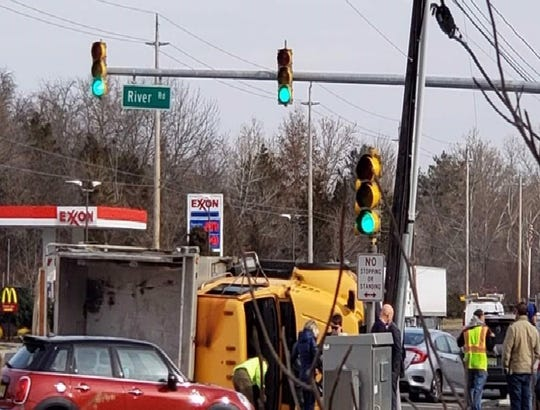 An overturned dump truck has closed Route 202 in the area of River Road in Branchburg.