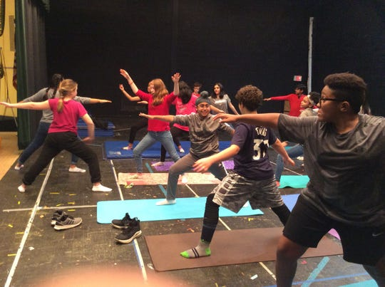 Middles School students learn about yoga