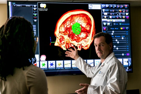 Dr. Thomas Steineke, chairman of the Neuroscience Institute at JFK Medical Center in Edison, walks a patient through a tour of their brain using Virtual Reality Medical Visualization technology provided by Surgical Theater.  The Neuroscience Institute is the only center in New Jersey to offer cutting-edge virtual reality surgery.