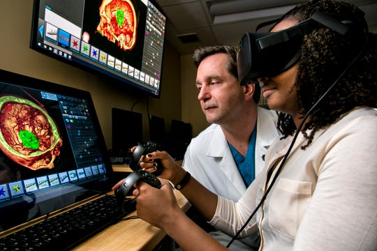 Dr. Thomas Steineke, chairman of the Neuroscience Institute at JFK Medical Center in Edison, walks a patient through a tour of their own anatomy using Virtual Reality Medical Visualization technology provided by Surgical Theater.  The Neuroscience Institute is the only center in New Jersey to offer cutting-edge virtual reality surgery.
