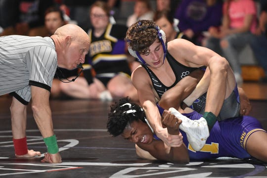 Norwalk's Austin Brenizer controls Indianola's Trey Kellow in a 126-pound match during a dual meet Thursday, Jan. 24, at Norwalk High School. Brenizer won by fall in 5:32. Indianola handed Norwalk its only Little Hawkeye Conference dual meet loss of the season, 37-29.