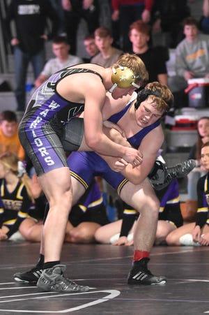 Indianola's Brennan Meacham controls the leg of Norwalk's Tristen Duncan in a 170-pound match Jan. 24 in a dual meet at Norwalk High School.