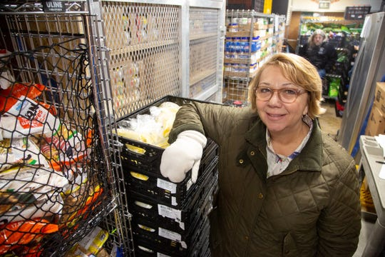 Terie Taylor-Wolf with United Way stands inside DMARC's mobile food pantry at the Des Moines International Airport to support federal workers affected by the government shutdown Monday, Jan. 28, 2019.