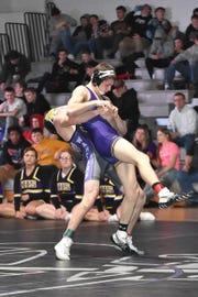 Norwalk's Landon Card throws Indianola's Brock Elbert in a 132-pound match Jan. 24 at Norwalk High School.