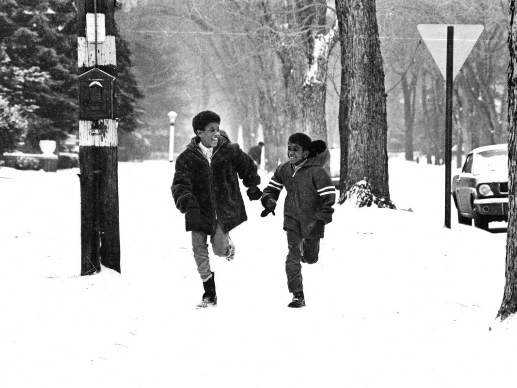 Two of the six Lucas children, Richard, 10, and John, 8, enjoy a neighborhood romp in after a brisk Michigan snow in 1969.