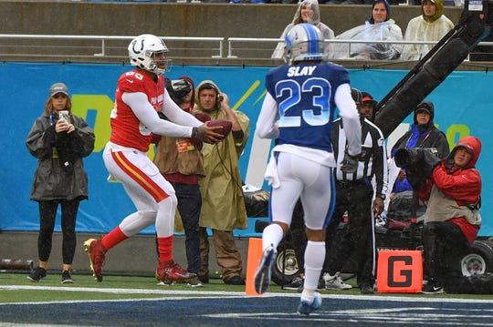 Eric Ebron scores past Darius Slay, his former Lions teammate, in the first quarter Sunday.