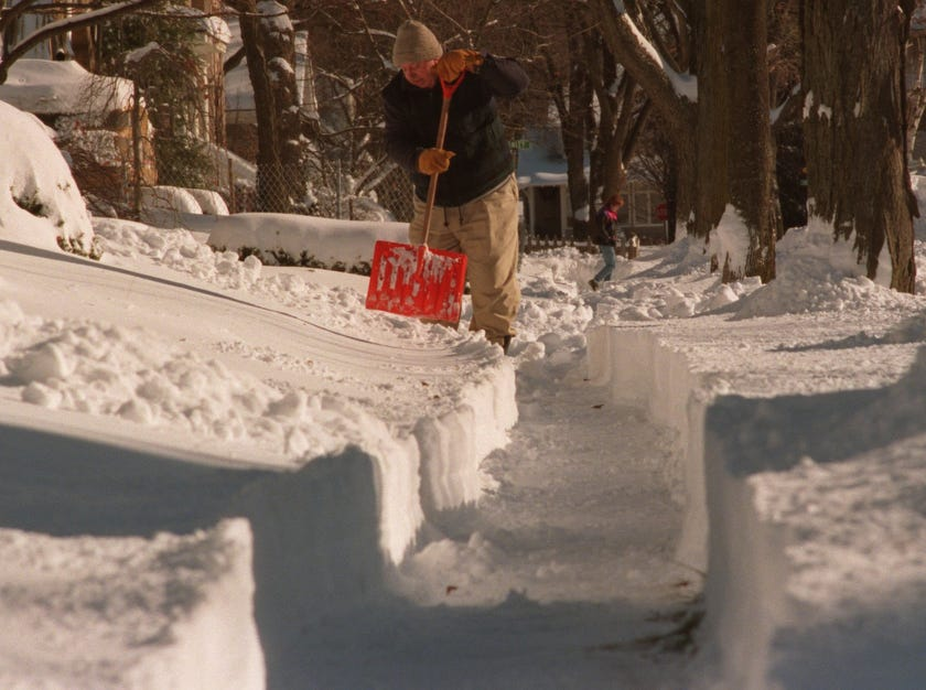 "A.M. Swart shovels out the walk in front of his home on Frank in Birmingham in 2000. ""Too much snow for me. Too much at one time."" he said."