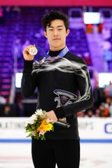 Nathan Chen holds up his gold medal after winning the senior men's championship during the 2019 U.S. Figure Skating Championships at Little Caesars Arena on Jan. 27, 2019 in Detroit.